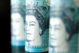 Dolar melonjak tertinggi empat minggu ketika sterling dan saham AS jatuh