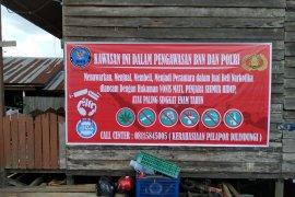 BNNK Samarinda pasang spanduk di kampung narkoba