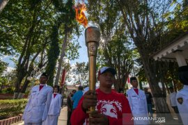 Obor Paskah Nasional dikirab di Kota Palu Page 1 Small
