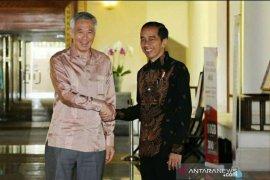 Presiden dan PM Singapura mengucapkan selamat ke Jokowi