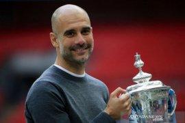 Pep lebih suka juarai Liga Inggris