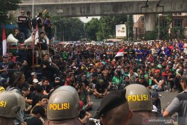 Yang menarik, Jakarta kemarin, demonstrasi di kantor Gojek hingga mafia properti