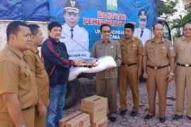 Dinsos Aceh serahkan bantuan bagi korban kebakaran di Aceh  Selatan