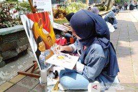 45 pelukis adu kemampuan di pendestrian sekitaran Kebun Raya Bogor