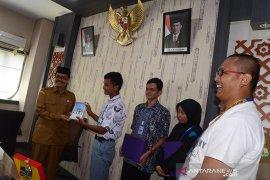 SMN Banten serahkan buku Bingkai Anak Negeri