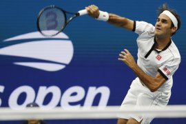 Federer melaju ke perempat final US Open