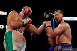 """Dapatkan 40 jahitan, Tyson Fury nyatakan siap """"perang"""" dengan Wilder"""