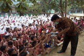 Aktifis gandeng RSUD Kotapinang dan PTPN3 bagikan 13 ribu masker