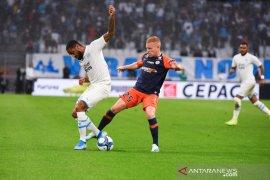 Tiga kartu merah hentikan kemenangan beruntun Marseille