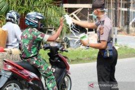 Polres Abdya bagi 10 ribu masker