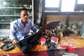 Asmadi si penyelam harta karun Kerajaan Sriwijaya
