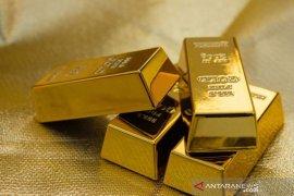 Akhir tahun, Harga Emas merangkak naik di tengah meningkatnya ekuitas dan dolar AS