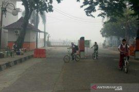 Kabut asap masih terjadi, sekolah di Palembang pulangkan siswa