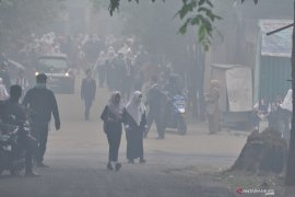 Kabut asap dari karhutla di Palembang semakin parah