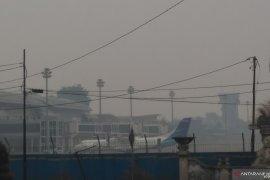 Dua pesawat tujuan Jambi kembali ke bandara asal akibat kabut asap