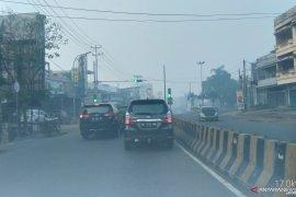 Sempat diguyur hujan deras, Kota Jambi masih diselimuti kabut asap