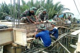 Satgas TMMD 106 Kodim 0314/Inhil Reteh Maksimalkan Pembuatan Jembatan Beton