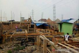 Pembangunan ratusan rumah yang terbakar di Palembang hampir selesai