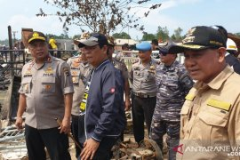 Governor and Police Chief review scene of fire disaster in Sebuku Island, Kotabaru