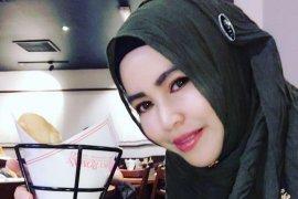 Nola Zain Salman, warga Singapura yang soroti wanita Banjar