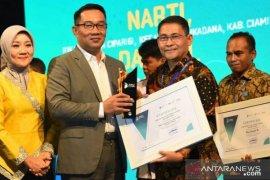 """Diskominfo Bogor menerima penghargaan """"Best Sapawarga Administor"""""""