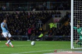 Piala Liga, duo Manchester dan Leicester melenggang ke semifinal