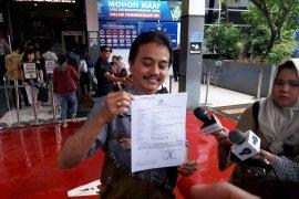 Roy Suryo melaporkan penyebaran hoaks oleh Sunda Empire ke polisi