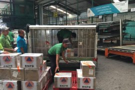 Garuda angkut bantuan 10.000 masker BNPB untuk WNI di  Tiongkok