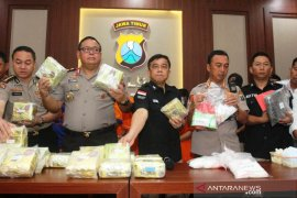 East Java police seize 15 kg of crystal meth smuggled from Malaysia