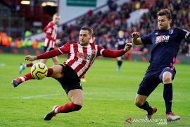 Sheffield United perpanjang kontrak Sharp dan Norwood