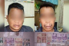 Timsus Gurita Polres Tanjungbalai tangkap dua tersangka judi togel