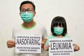 """Ayah dan anak penyintas kanker resah akibat harga masker """"selangit"""""""