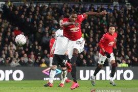 Manchester United melangkah ke perempat final Piala FA