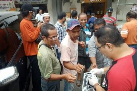 Gerakan Bergotong Royong bagikan masker gratis kepada masyarakat antisipasi penyebaran virus corona