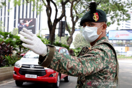 Berita dunia - Malaysia kerahkan pasukan untuk tegakkan pembatasan terkait virus