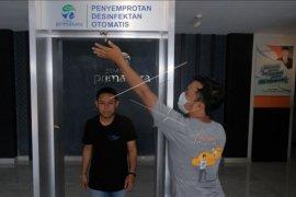 Pengembangan gerbang penyemprot disinfektan otomatis