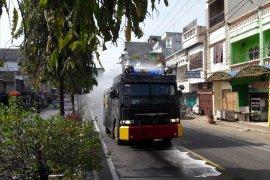 Polres Langkat semprot disinfektan tiga kecamatan