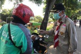 Pramuka Kwarda Banten bagikan 3.000 masker dan cairan pembersih tangan