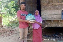 Setelah jalani karantina mandiri, pria di Aceh Utara bagi-bagi sembako