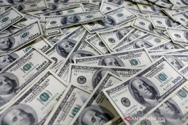 Dolar menguat setelah Fed meningkatkan prospek ekonomi AS