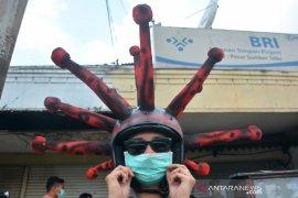 Cara Unik Sosialisasi Penggunaan Masker