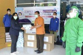 Udinus Semarang produksi pelindung  wajah bagi tenaga medis