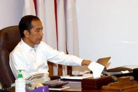 Upaya yang dilakukan Jokowi bendung PHK di sektor rill