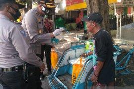 Polres Situbondo bagikan ratusan paket sembako untuk masyarakat