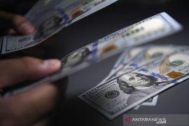 Dolar Amerika sedikit menguat di tengah data ekonomi suram