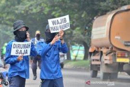 Warga yang tidak pakai masker dikenai sanksi dan KTP ditahan