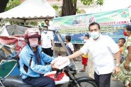 PTPN IV bagikan ribuan nasi kotak kepada warga sekitar terdampak COVID19