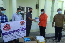PP KSBWI Kukar Serahkan Bantuan APD Bagi Tenaga Medis