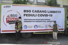 Bank SulutGo cabang Limboto berikan bantuan APD dan bahan pokok