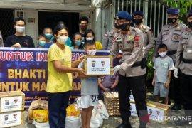 Sat Brimob Polda Sumut beri bantuan sembako untuk Panti Asuhan di Medan